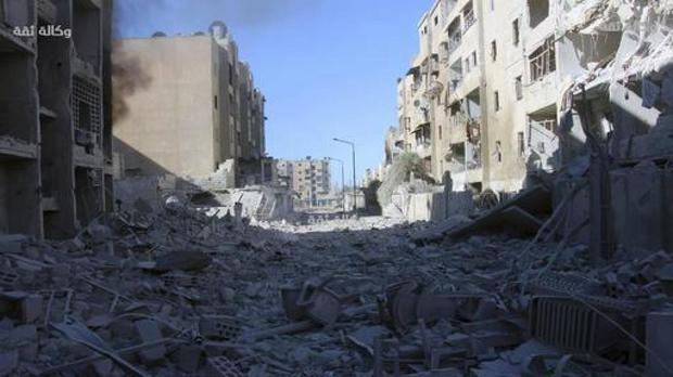 Damaged buildings after airstrikes hit the Al-Shaar neighborhood of Aleppo, Syria (Thiqa News Agency/AP)
