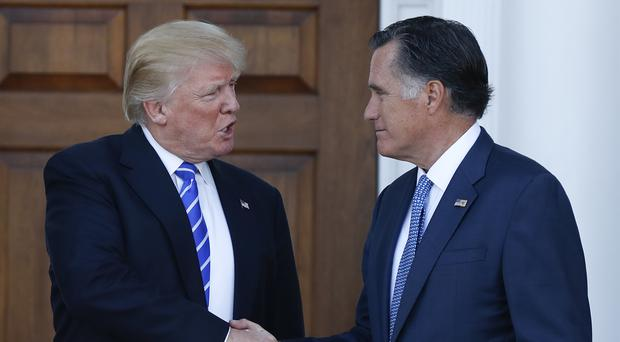 President-elect Donald Trump and Mitt Romney shake hands (AP)