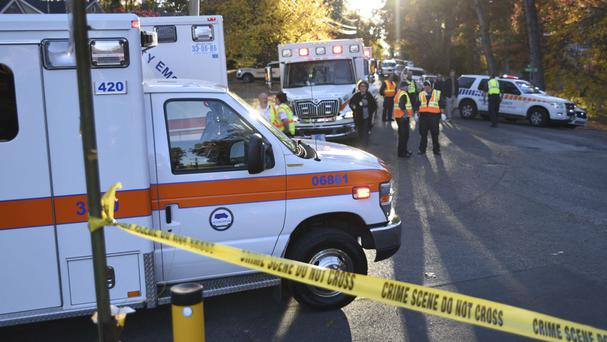 The emergency services at the scene of a fatal school bus crash in Chattanooga (Chattanooga Times Free Press/AP)