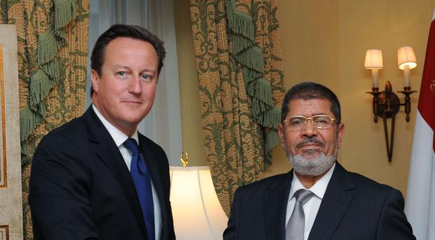 Mohamed Morsi meets then prime minister David Cameron in New York in 2012