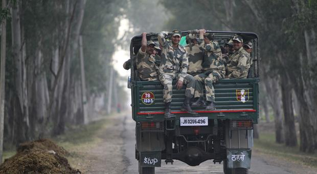 Indian soldiers travel in a truck along the India-Pakistan border (AP)