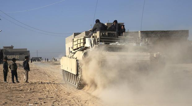 Iraqi special forces soldiers on a tank in Mosul (AP)