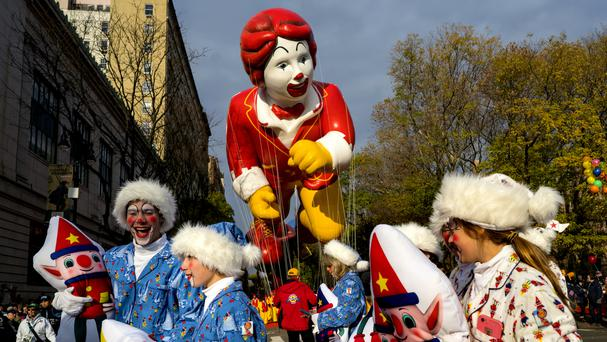 People walk along Central Park West at the start of the Macy's Thanksgiving Day Parade in New York (AP)