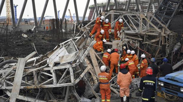 Rescues workers look for survivors after China's latest construction site disaster (Xinhua News Agency/AP)