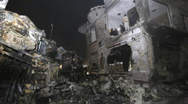 Civilians search for survivors in the rubble after a car bomb attack near the city of Hilla (AP)