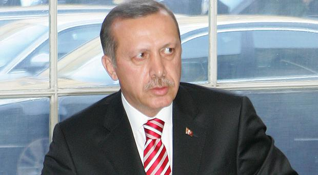 Recep Tayyip Erdogan was giving his first speech since Thursday's approval of a non-binding resolution calling on the EU to freeze Turkey's membership talks