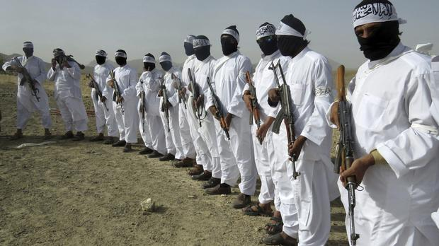 Taliban suicide bombers stand guard during a gathering of a breakaway Taliban faction, in the border area of Zabul province, Afghanistan (AP)