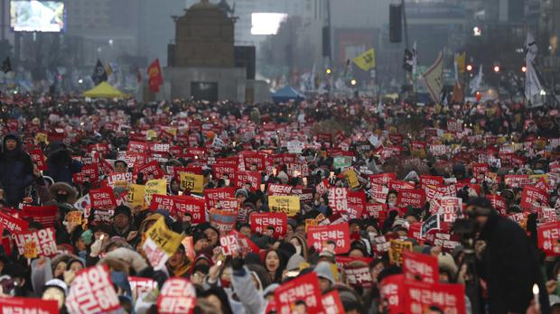 South Korean protesters call for President Park Geun-hye to step down (AP)