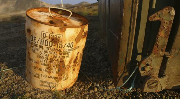 A rusty container of lubricant oil for a US military vehicle among abandoned US material outside Kulusuk (AP)