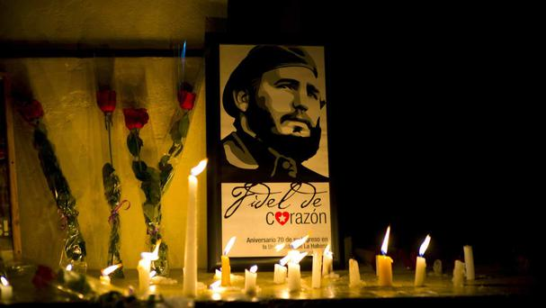 An image of Fidel Castro, surrounded by candles and roses, at the university where he studied law as a young man in Havana (AP)