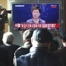 A TV at Seoul station shows the live broadcast of President Park Geun-hye (AP)