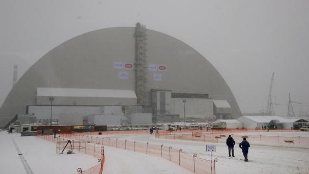 Workers inspect the New Safe Confinement (NSC) movable enclosure in Chernobyl, Ukraine (AP)