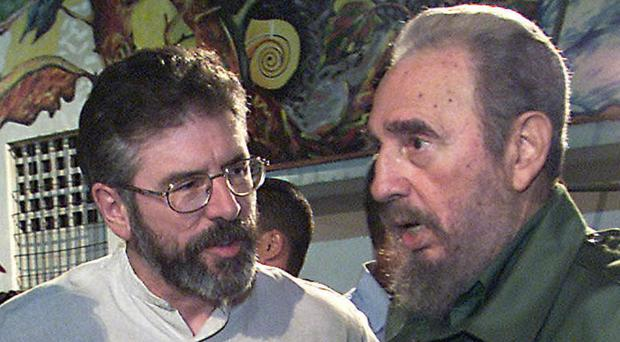 Sinn Fein president Gerry Adams, left, with Fidel Castro at the opening of a school in Havana