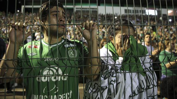 Tearful Chapecoense fans pay tribute to the players at Arena Condado stadium in Chapeco (AP)