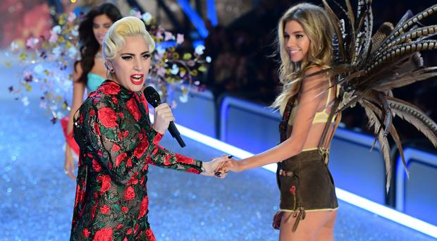 Lady Gaga and a model on the catwalk during the Victoria's Secret fashion show.