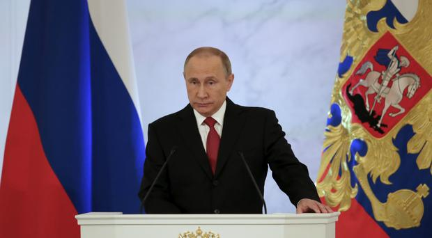 Russian President Vladimir Putin gives his annual state of the nation address in the Kremlin (AP)
