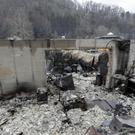 Some walls of a burned-out business remain in Gatlinburg (AP)