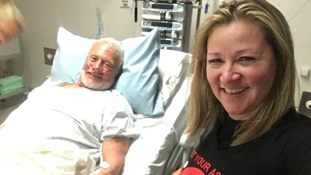 Buzz Aldrin with Christina Korp in hospital in Christchurch, New Zealand (Christina Korp/AP)