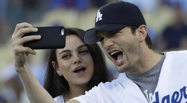 Ashton Kutcher and wife Mila Kunis have become parents for the second time (AP)