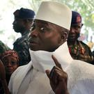 Yahya Jammeh arrives to vote in the election in Banjul, Gambia (AP)