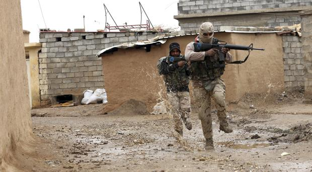 Iraqi soldiers secure streets in a recently liberated village occupied by Islamic State outside Mosul (AP)
