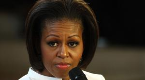 US first lady Michelle Obama, pictured, was referred to as 'monkey face' by a Denver doctor