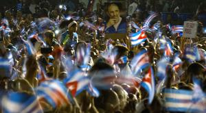 People gather for the last time in Santiago to honour Cuba's late leader Fidel Castro (AP)