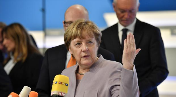 The state of Bavaria criticised Angela Merkel's decision in 2015 to let in asylum-seekers who were stuck in Hungary (AP)