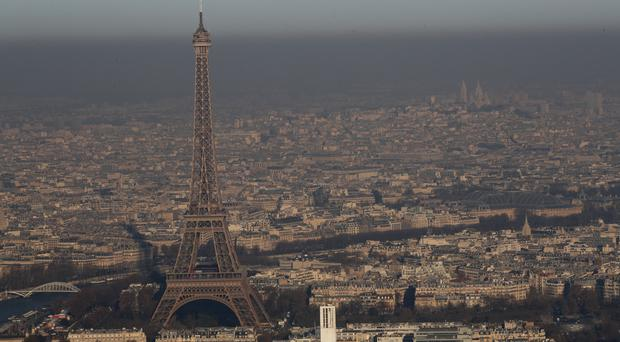 The Eiffel Tower is seen from a hot-air balloon as Paris suffers a pollution spike (AP)