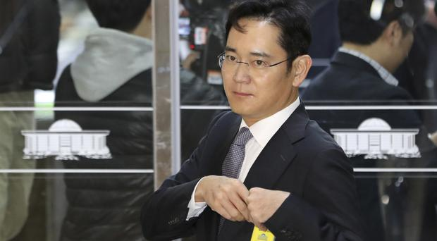 Lee Jae-yong arrives for the hearing at the National Assembly in Seoul (AP)