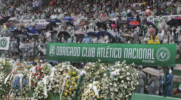 Chapecoense football fans at a funeral ceremony in tribute to the victims (AP)