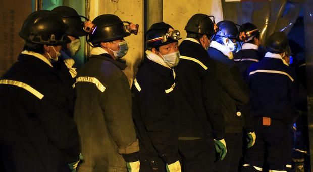 Rescuers prepare to enter the site of a previous accident in the city of Chifeng (Xinhua/AP)