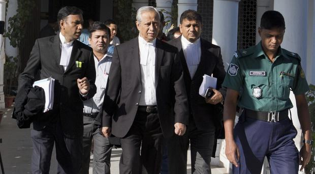 Bangladesh Attorney General Mahbubey Alam, centre, leaves the Supreme Court after a hearing relating to the death sentence imposed on Harkatul Jihad leader Mufti Abdul Hannan (AP)