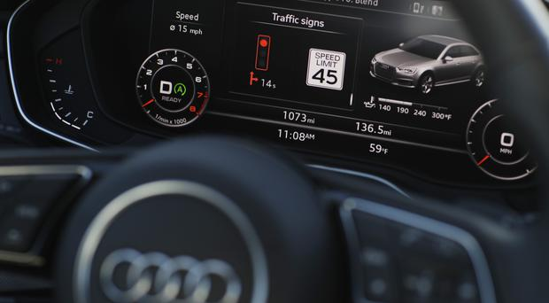 The dashboard of an Audi A4 during a demonstration of Audi's vehicle-to-infrastructure technology in Las Vegas (AP)