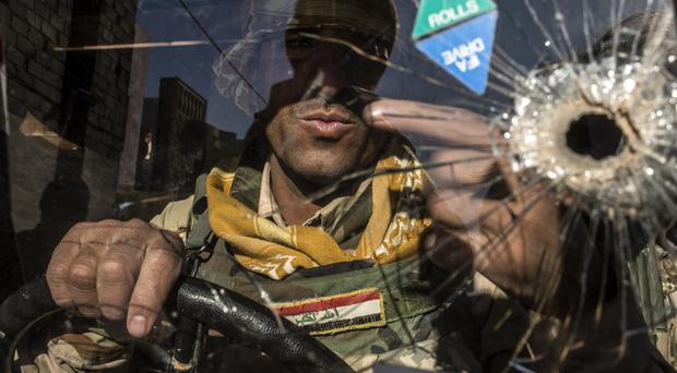 An Iraqi soldier in a Humvee in Mosul (AP)