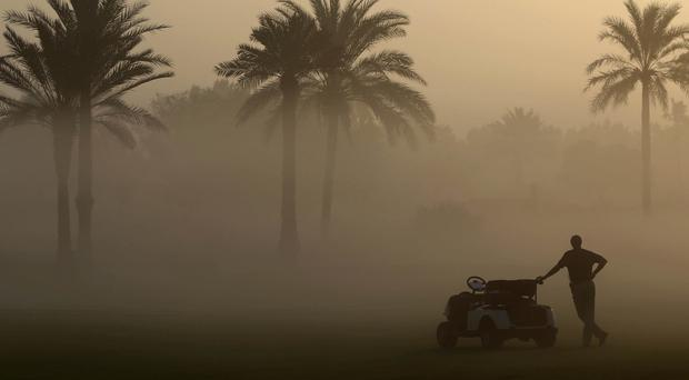 Early-morning fog at the Dubai Ladies Masters golf tournament (AP)