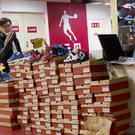 A man shops for shoes at a Qiaodan Sports retail shop in Beijing, China (AP)