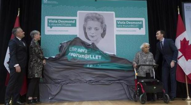 An image of Viola Desmond, who will be featured on the new Canadian 10 dollar bill, is unveiled in Gatineau, Quebec (Adrian Wyld/The Canadian Press via AP)