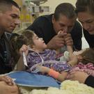 The family of conjoined twins Erika and Eva Sandoval (Sacramento Bee/AP)