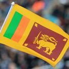A Sri Lanka fan holds up a flag