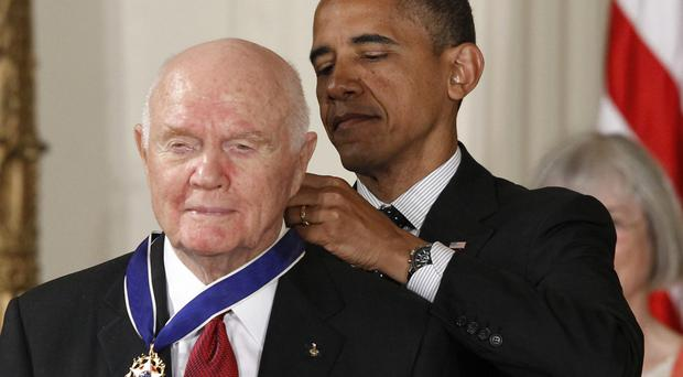 John Glenn, pictured being awarded the Medal of Freedom from US President Barack Obama in 2012, has died aged 95 (AP)