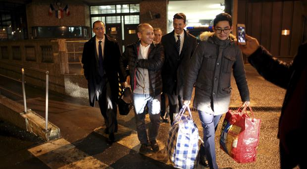 Mukhtar Ablyazov, second from left, leaves the Fleury Merogis prison, escorted by his son Madiyar, right, and his lawyers, in Fleury Merogis, south of Paris (AP)