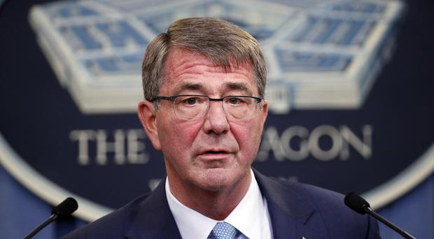 Ash Carter said the extra troops will help local forces in their push to retake Raqqa (AP)
