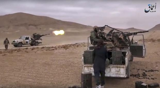 Islamic State have recaptured the Syrian city of Palmyra nine months after being forced to withdraw. (Militant Video via AP)