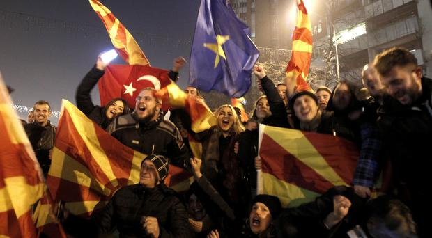Supporters of the leftist SDSM celebrate after the general election in Skopje, Macedonia (AP)