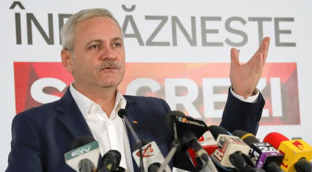 The head of the Social Democrat Party, Liviu Dragnea, speaks to media after exit polls were announced in the parliamentary elections, in Bucharest, Romania (AP)