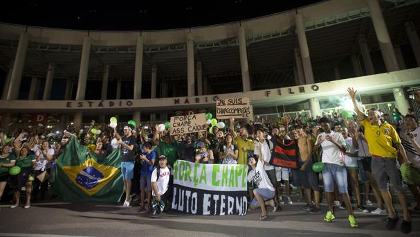 Chapecoense fans gather for a tribute to the victims of an airplane crash, outside the Maracana stadium, in Rio de Janeiro (AP)