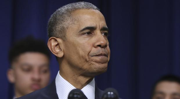 US president Barack Obama has vowed America will take action on Russian hacking (AP)
