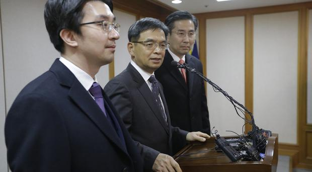 Lee Joong-hwan, centre, a lawyer for impeached South Korean President Park Geun-hye, speaks during a press conference at the Constitutional Court in Seoul (AP)