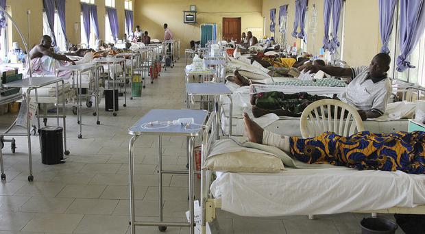 Victims of the collapsed Reigners Bible Church International building receive treatment (AP)